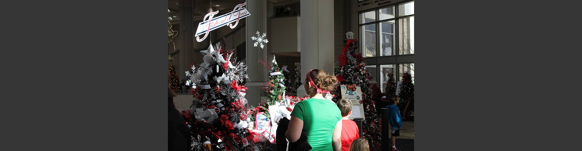 image of patrons viewing tree displays at the Festival of Trees